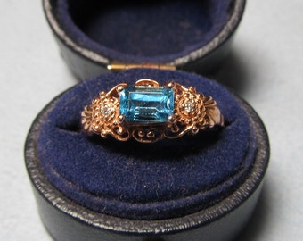 Cinderella Blue Topaz and 14 Karat Pink Gold Vintage Ring with Diamonds