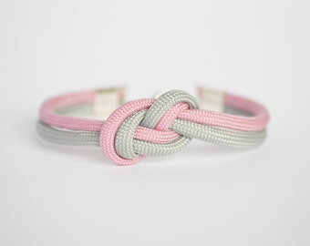 Light pink and gunmetal gray infinity knot parachute cord rope bracelet