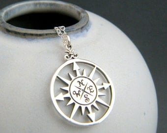 large silver compass necklace. simple everyday jewelry. sterling silver pendant. starburst points. directions. travel traveler. gift for her