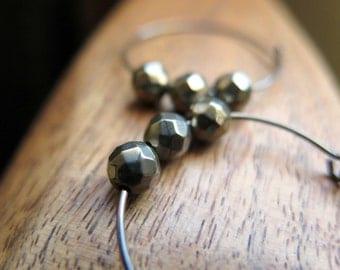 fools gold hoop earrings. metallic niobium hoops. pyrite earrings.