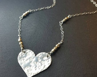 Silver hammered heart festoon with gold beaded chain