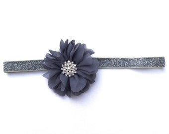 Glitter stretch headband in grey chiffon and silver with a pearl snowflake rhinestone center. Great Gatsby New Year's Eve.