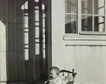1930's Baby Photo - Child Sat Outside in a High Chair