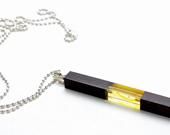 Amber, Sterling Silver and Ebony Wood pendant - wood with amber approximately 7cm long.