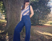High-waisted Denim sailor slacks with wooden buttons and suspenders