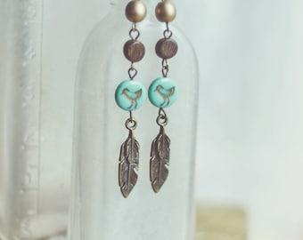 bluebird feather earrings.