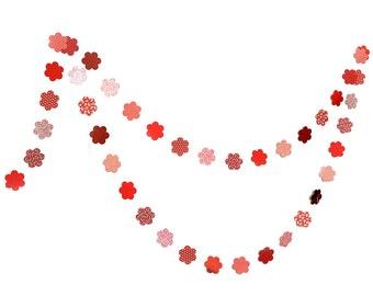 Red garland in cardboard flowers