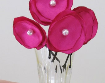four pink flower bobby pins, hair pins