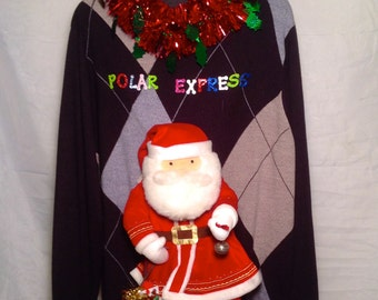 Polar Express Santa with a bag full of toys as he rings in the big day An awesome mens sweater size XLT Argyle Christmas in July