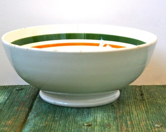 Deep ceramic bowl with green and orange stripes