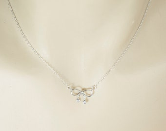 Tiny Bow Necklace. Silver Bow Necklace. Bridesmaid Necklace. Bridal Necklace. Flowergirl Gift. Minimalist Jewelry. Sweet 16 Birthday Gift