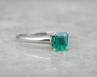 Contemporary Emerald Solitaire Engagement Ring in Platinum D11U1L-P