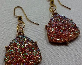 Pink bedazzled dangle earrings.