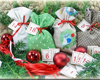 Advent calendar with embroidered numbers, 24 little bags in green natural