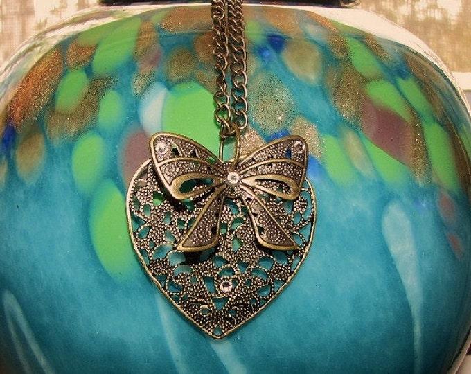 JEWELRY- PENDANT; brass heart, brass bow, four Swarovski elements crystals, 22 inch brass chain, teenage, women, Anniversary,
