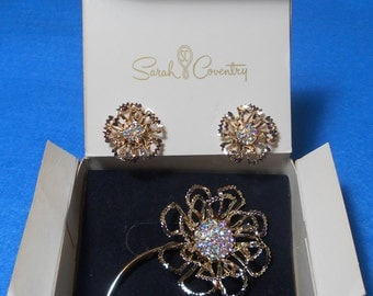 """SALE! 1969 Boxed Sarah Coventry Gold Tone Aurora Borealis """"Allusion"""" Flower Brooch & Clip On Earrings Set"""