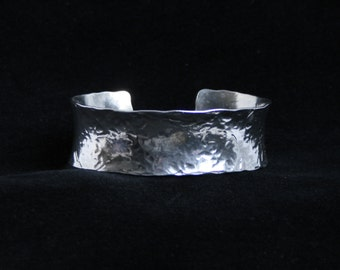 Medium anticlastic cuff bracelet 'Lydia' Traditionally hand made with hammered finish for added sparkle. Fully UK Hallmarked Sterling Silver