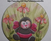 Hand painted Small Round Wooden Magnet with a Ladybug painted on it in Red, Black, Green and Pink, Cute Gift for a special friend, happy