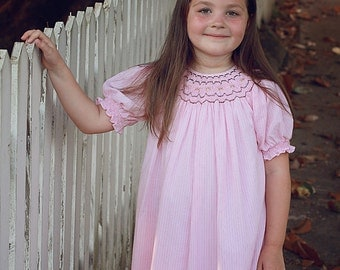 Baby Girls pink dress, hand smocked around  the collar and sleeves, spring, summer, portraits, beach, birthday, sizes av 3m to 7 years 17870