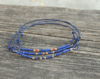 Adjustable bracelet of Lapislazuli beads