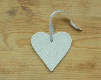 Large white clay ceramic Valentines day heart ornament with lace pattern.