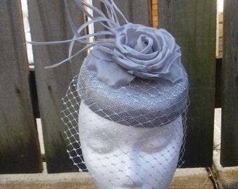 Silver sinamay fascinator with netting  (Pillbox)