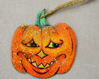 Grinning and glancing Halloween Pumpkin Ornament
