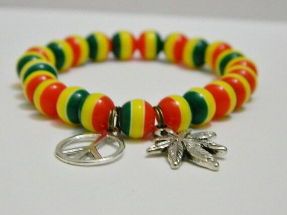 plastic rasta bead stretch bracelet with pot leaf charm
