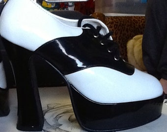 Vintage platform Saddle Shoes High heels. Not Your Aunt Mary's Saddle Shoes! Size 8  Never worn.