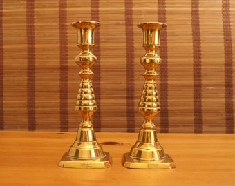 2 Vintage push up candle holders / candle sticks || solid brass || reg No. 223580 || England