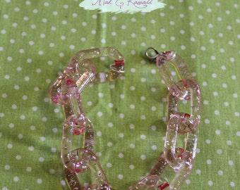 transparent pink plastic chain bracelet