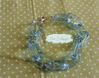 Transparent blue plastic chain bracelet