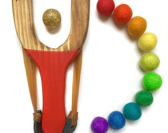 Golden Rainbow Wooden Slingshot toy with 11 colorful wool felt balls ammo and gold glitter ball, hand painted handles, fun color mix toys
