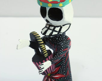Wooden skeleton Day of the Dead, Dia de Muertos, holding basket