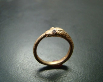 Beautiful and Unique 14k gold ouroborus snake ring with genuine diamond eyes