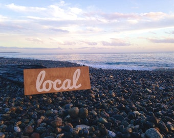 Local hand painted sign on reclaimed wood