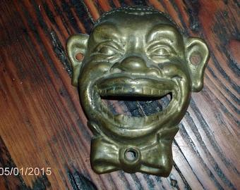 vintage Black memorabilia cast iron bottle opener