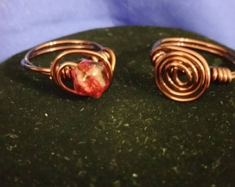 Infinity King and Queen Ring with Red crystal.