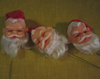 "3 Santa heads on wire for dolls, 2"", plastic with hats"
