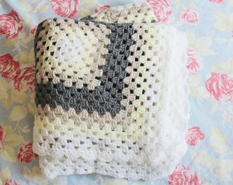 Cosy afghan granny square blanket in neutral colours