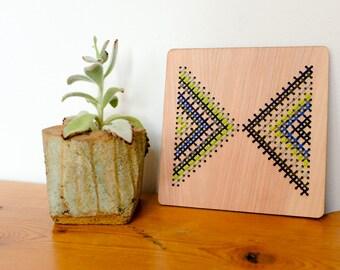 "Modern Geometric Cross Stitch, Laser Cut Birch Wall Hanging, 6"" x 6"", Opposing Triangles, Greens, Blues and Greys"