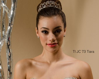TI JC 73 - An exquisitely crafted tiara. This tiara is made with opulent rhinestones to enrich that regal look on your special day.