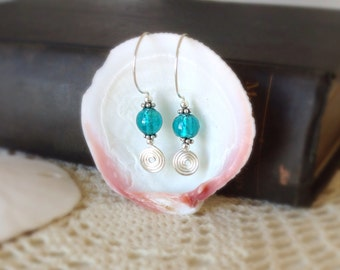 MediterraneanSwirl- Aquamarine, hand blown glass beads lined with silver foil, surrounded by handcrafted wire work and original silver hooks