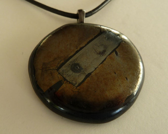 Black and gold glass pendant, made from iridescent, metallic gold, pewter & black fused glass.