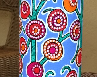 Hand painted cylindrical repurposed cardboard bottle container