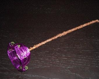 Purple wire woven flower.