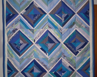 Beautiful blue and white diamonds small quilt, made from mixed fabrics.