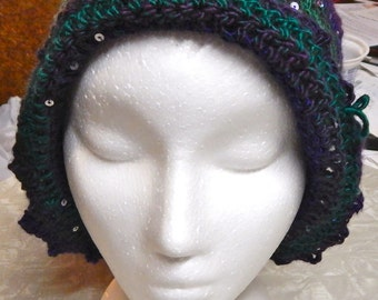 Purple, green, and sparkly crocheted hat