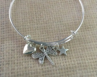 Bracelet with heart, fire fly and star charms
