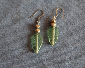 Handmade green glass leaf and metal bead earrings